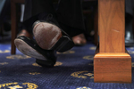 The shoes of former Special Counsel Robert Mueller are seen as he testifies before a House Intelligence Committee hearing on the Office of Special Counsel's investigation into Russian Interference in the 2016 Presidential Election{quote} on Capitol Hill in Washington, U.S., July 24, 2019. REUTERS/Leah Millis