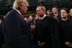 U.S. President Donald Trump talks to Supreme Court Chief Justice John Roberts while Associate Justice Elena Kagan looks on as the president arrives to U.S. President Donald Trump delivers his State of the Union address to a joint session of the U.S. Congress in the House Chamber of the U.S. Capitol in Washington, U.S., February 3, 2020. REUTERS/Leah Millis/POOL