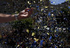 JaVale McGee takes in the scene as thousands of fans cheer during the Warriors' 2017 NBA Championship parade June 15, 2017 in Oakland, Calif.