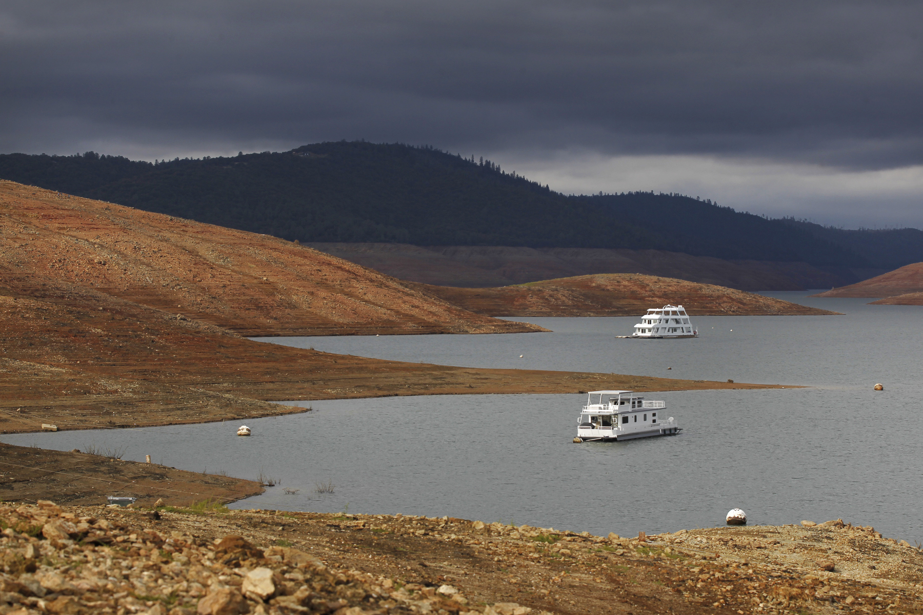 House boats sit idle in the low water of Lake Oroville Nov. 29, 2014 in Oroville, Calif. Despite recent rainfall, California's second largest reservoir is near the 1977 historic low at 26 percent of capacity. {quote}This has been quite the progression,{quote} said longtime resident Sharon Smith, who has been walking the dam since she moved to the area in 1997. {quote}It seems like it's happening so fast,{quote} she said.