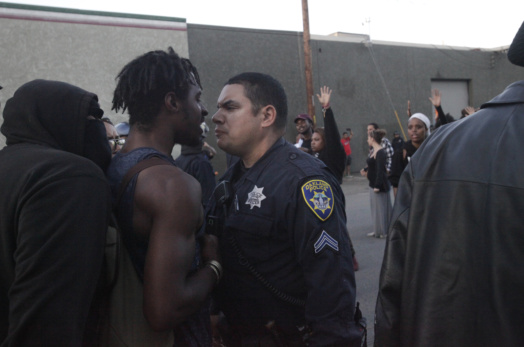 A police officer and a protester have a tense moment before a scuffle breaks out between a different protester and police officers near the port during an {quote}F the Police{quote} march held in solidarity with Ferguson, Mo., where there was a fatal shooting of an unarmed 18-year-old black man earlier in the week August 15, 2014 in Oakland, Calif.