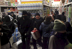 Protesters loot the grocery store Smart and Final after some vandalized the front and broke the windows during a protest against the grand jury's decision not to indict the white police officer who fatally shot an unarmed black teenager months ago in Ferguson Nov. 24, 2014 in Oakland, Calif.