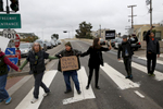 People hold hands and block the 101 south freeway entrance and exit ramps at the intersection of Octavia and Market streets during a {quote}LGBT Rally and March for an End to Police Violence{quote} Dec. 24, 2014 in San Francisco, Calif.