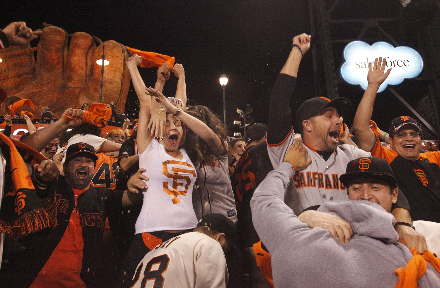Fans, from left, Rick Oropeza, Yana Borovlev, Ashley Henry, Roman Kreslavsky, Joey Juarez, Josh Jemelka and Carlos Rizo celebrate after the Giants win game five of the NLCS at AT&T Park Oct. 16, 2014 in San Francisco, Calif.
