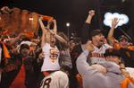 Fans, from left, Rick Oropeza, Yana Borovlev, Ashley Henry, Roman Kreslavsky, Joey Juarez, Josh Jemelka and Carlos Rizo celebrate after the Giants win game five of the NLCS at AT&T Park Oct. 16, 2014 in San Francisco, Calif.