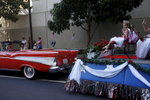 Josie Hussussian, 6, front right, sits with others in the Redwood City, San Mateo County Princess Program members, as they practice their waves before the annual Fourth of July Parade July 4, 2014 in downtown Redwood City, Calif. The parade is the largest and oldest fourth of July parade in the bay area.