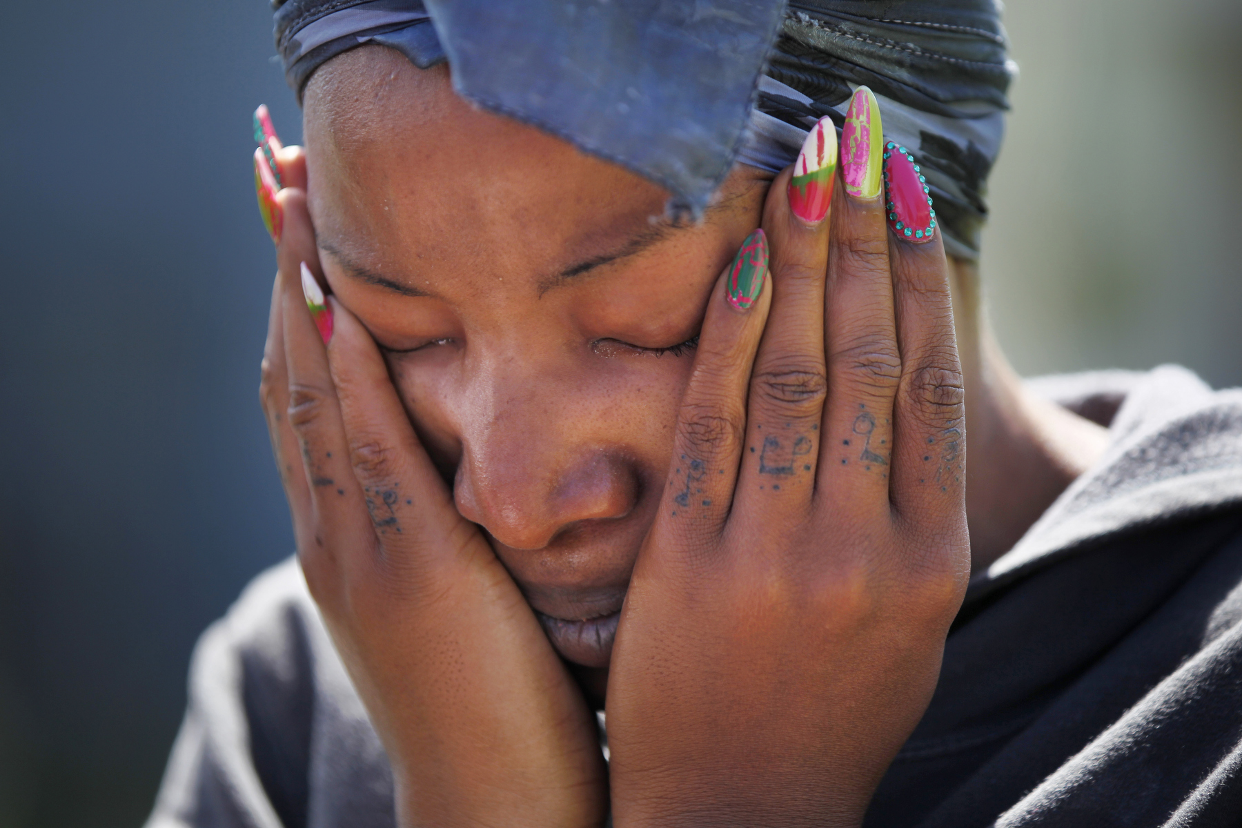 Davina Brooks, 26, becomes emotional as she tells media about getting the call that the apartment her nephew lived in was on fire as she stands at the scene in Sunnydale April 16, 2014 in San Francisco, Calif. There has been one confirmed death as a result of the Wednesday morning blaze. Brooks, who now lives in San Mateo, rushed to the scene as soon as she heard, fearing that her 3-year-old nephew didn\'t make it.