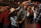 From left, Birza Santiago, 26, Brian Boyce, 30, Stacey Garcia, 31, and Jesus Jocobo, 37, laugh as they do a group dance move together during the monthly barn dance May 17, 2014 at Pie Ranch in Pescadero, Calif. Every month, the educational farm holds a work day and welcomes people to volunteer at the farm. Afterwards, people gather for a potluck and then an evening of traditional barn dancing with a caller and a live band. Margaret More has been attending the dance for eight years, she says she enjoys the intergenerational aspect and added, {quote}it feels like [we've] stepped back 150 years in civilization.{quote}