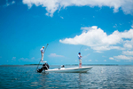fighing guide and fly fisherman on a skiff in the ocean off the florida keys
