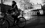 A woman bikes on the place of the Republique in Paris where the Paris motto {quote}Fluctuat nec mergitur{quote} which means {quote}tossed but not sunk{quote} in Latin has been painted, on December 28, 2015, Paris, France.