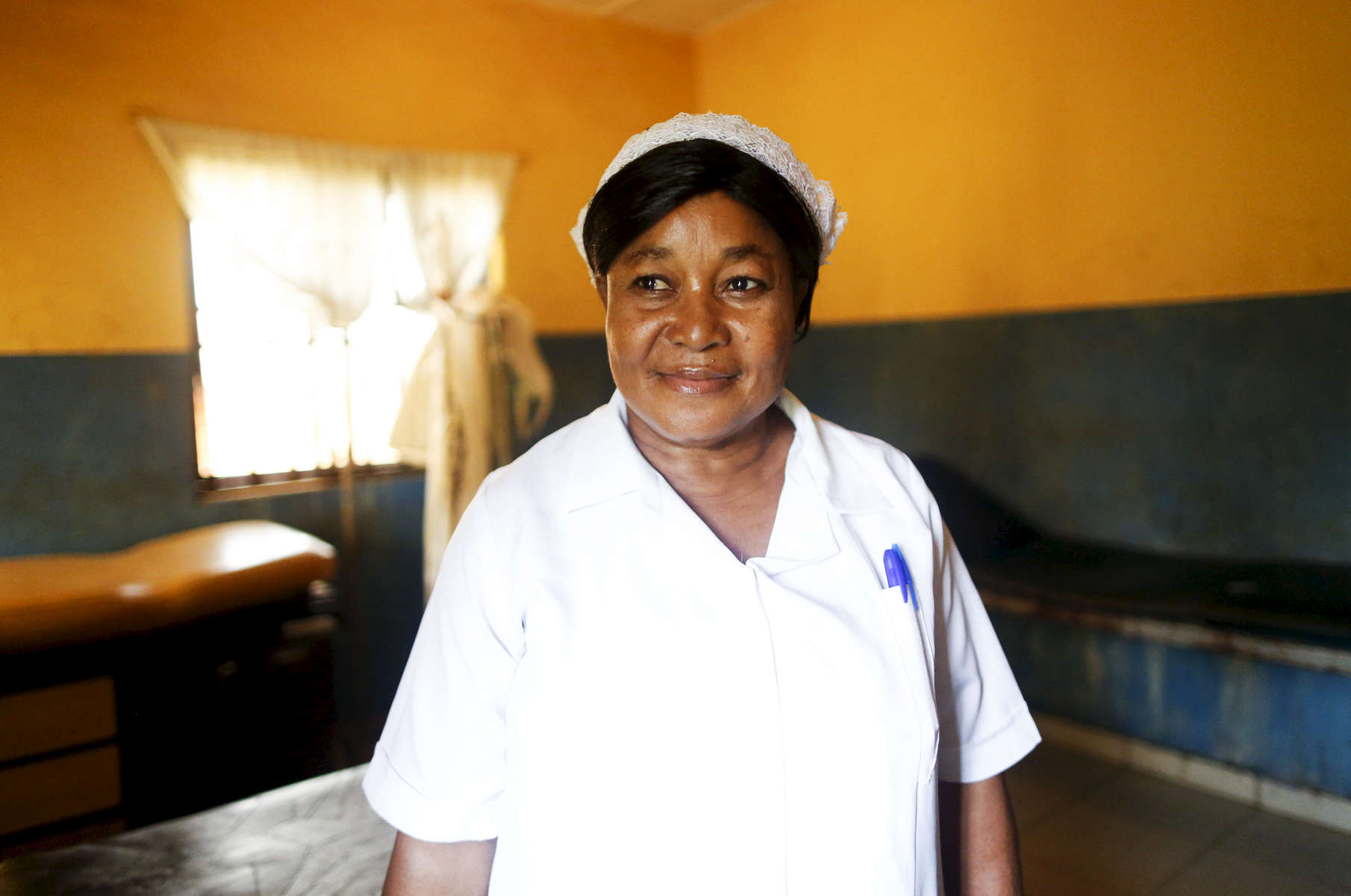 Nurse Williams in the delivery room of the medical facility of Kuchigoro in Abuja, Nigeria.