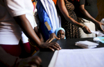 Pregnant patients wait for a consultation at the medical facility of Kuchigoro  in Abuja, Nigeria.