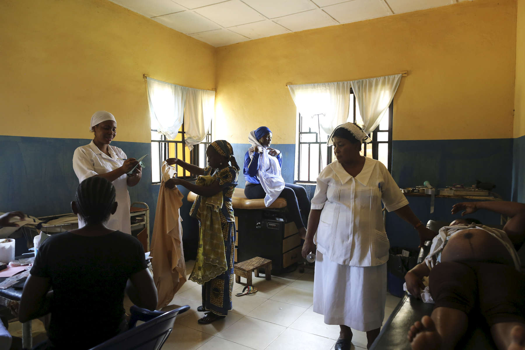 Pregnant women get their check up at the medical facility of Kuchigoro in Abuja, Nigeria.