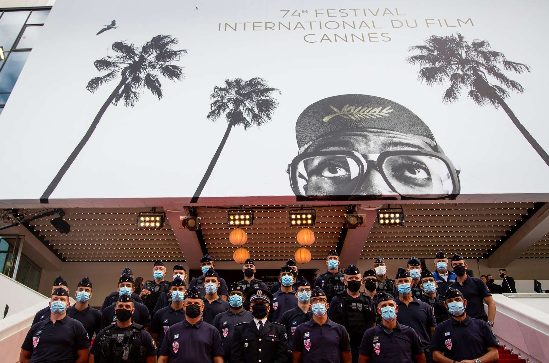 Policemen pose for a picture on the red carpet at the 74th annual Cannes Film Festival in Cannes, France on July 16, 2021.