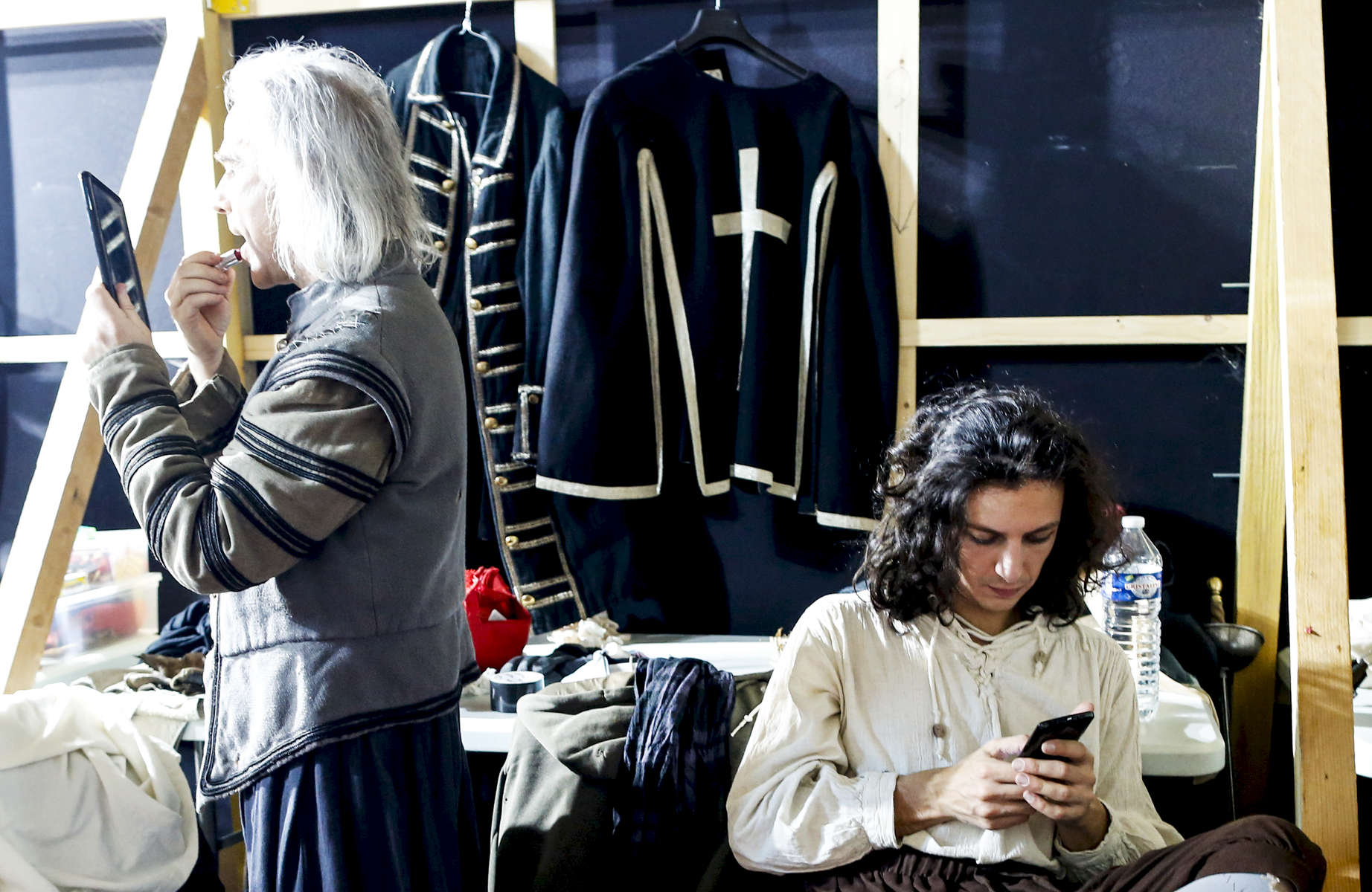 Didier Le Gal and Lorenzo Bello are getting ready backstage before a performance.
