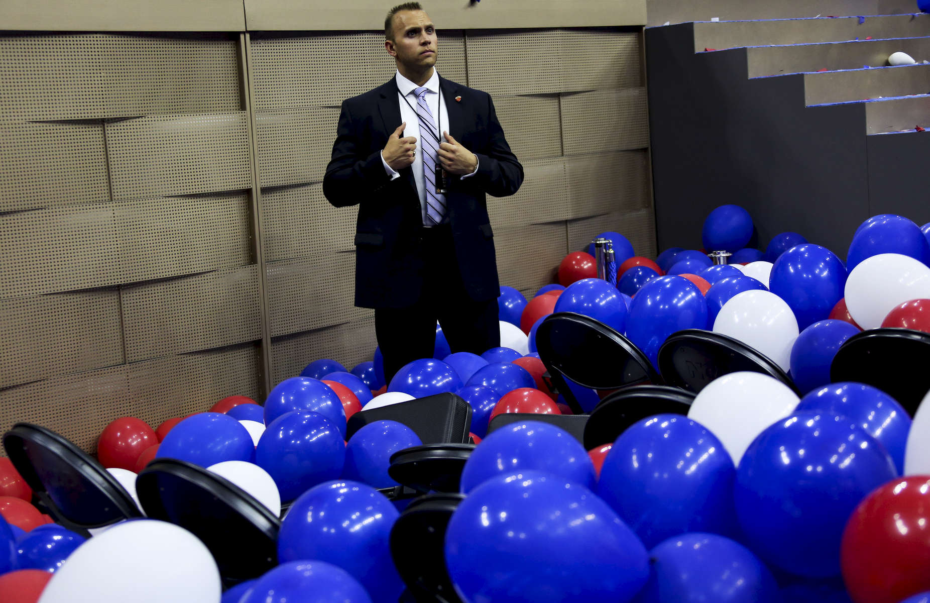 A Secret service agent stands in the balloons at the end of the DNC