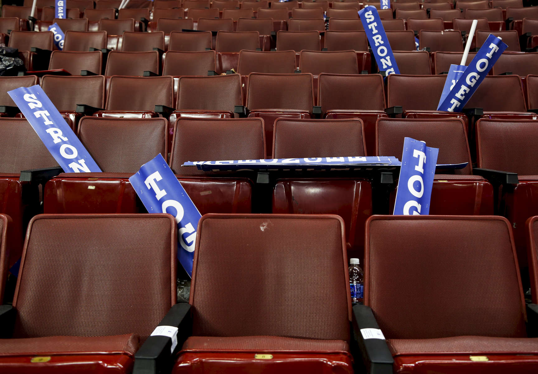Signs saying {quote}stronger together{quote} lay on empty seats at the end of the DNC.