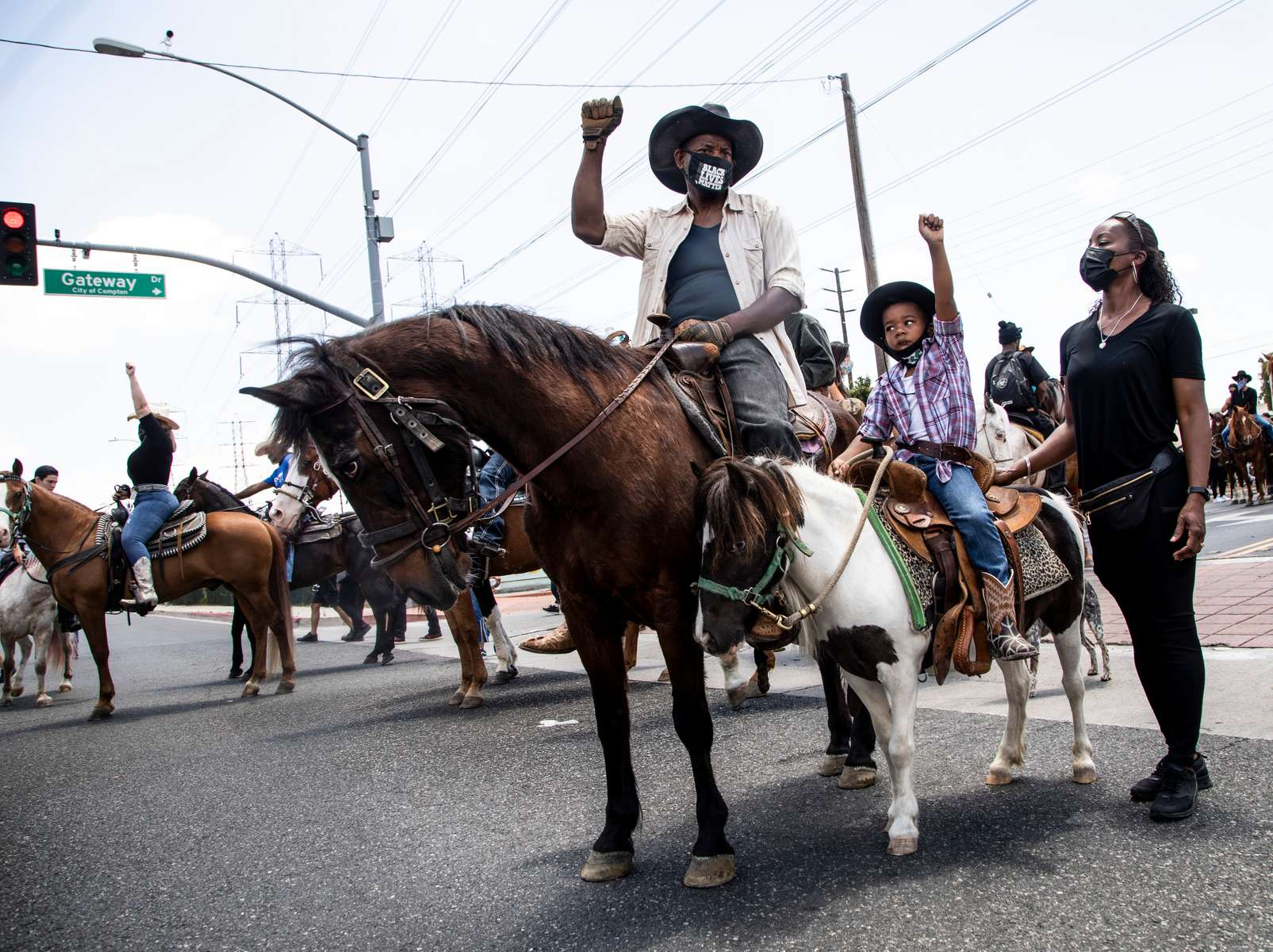 The Compton Cowboys ride along with a thousand walking protesters during a {quote}peace ride{quote} for George Floyd  on June 7, 2020, in Compton, California.This is the 13th day of protests since George Floyd died in Minneapolis police custody on May 25.