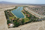 An aerial view shows the artificial lake, Shadow Lake Estates, next to desert landscape as California faces its worst drought since 1977, in Palm Springs, California, U.S., June 29, 2021. Picture taken with a drone June 29, 2021.