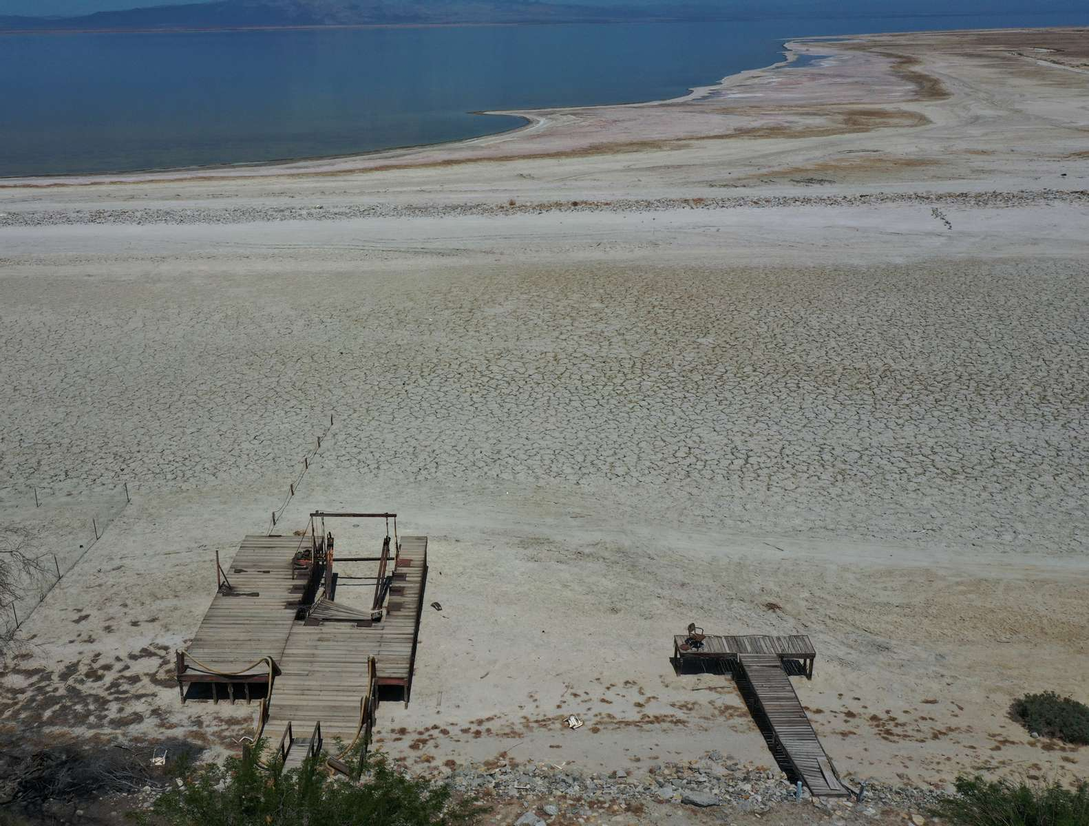 An aerial view shows former boat launches on a Salton Sea's beach, with the water much further away, as California faces its worst drought since 1977, in Salton City, California, U.S., July 4, 2021.