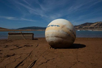 A buoy and its concrete anchor lay on the dry ground at Lake Oroville, California, U.S., June 16, 2021. Lake Oroville, the second largest reservoir in California is currently at 35% capacity.