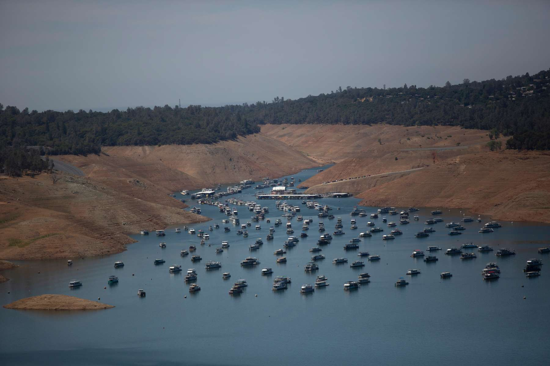Houseboats are anchored in low water levels at Lake Oroville, which is the second largest reservoir in California and according to daily reports of the state's Department of Water Resources is near 35% capacity, near Oroville, California, U.S., June 16, 2021. Picture taken June 16, 2021.