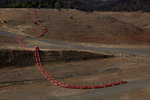 A floating security barrier is seen at a section that used to be underwater at Lake Oroville which is the second largest reservoir in California and according to daily reports of the state's Department of Water Resources is near 35% capacity, near Oroville, California, U.S., June 16, 2021. Picture taken June 16, 2021.