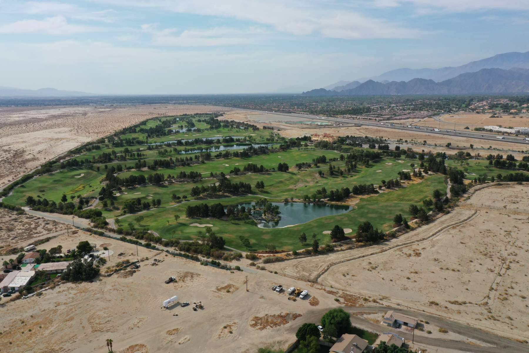 An aerial view shows a golf course next to desert landscape as California faces its worst drought since 1977, in Palm Springs, California, U.S., June 29, 2021. Picture taken with a drone June 29, 2021.