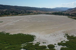 An aerial view shows Elizabeth Lake, that has been dried up for several years, as the region experiences extreme heat and drought conditions, in Elizabeth Lake, an unincorporated community in Los Angeles County, California, U.S., June 18, 2021. Picture taken with a drone June 18, 2021.