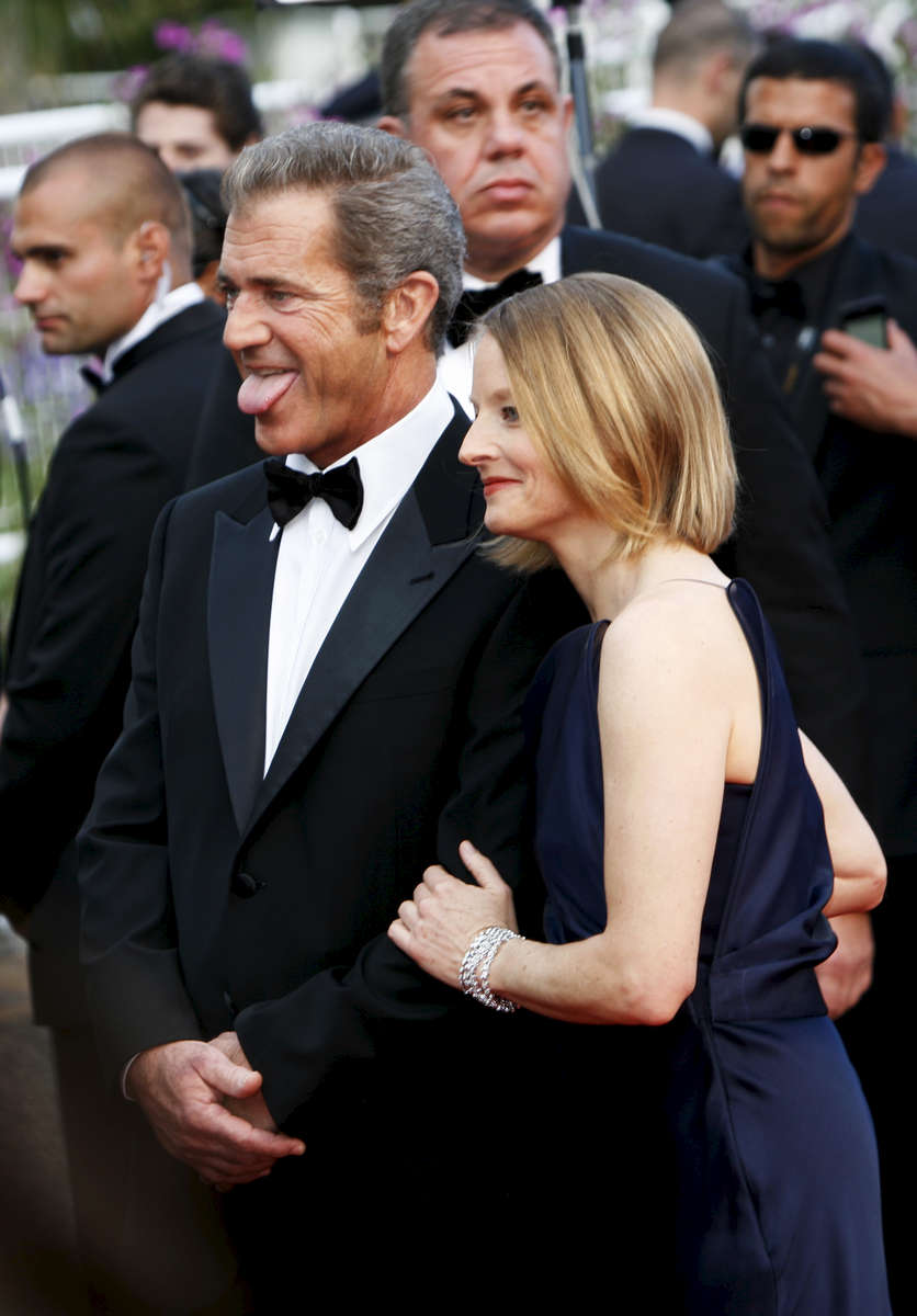 Director Jodie Foster (R) and  actor Mel Gibson arrive at the screening of the {quote}Beaver{quote}  at the Palais des Festivals during the Cannes Film Festival in Cannes, France.