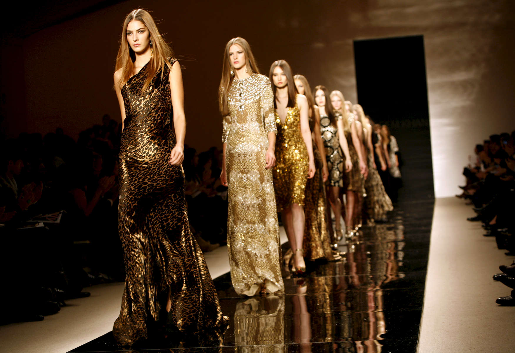 Models walk the runway at the end of the Naeem Khan fashion show, at the New York fashion week, in New York.