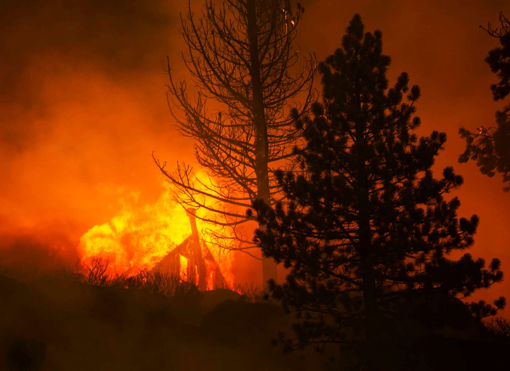 A structure burns as the Caldor fire rages on August 30, 2021, in Echo summit, California. The Caldor Fire has burned almost 200.000 acres, destroyed over 660 structures and is currently 16 percent contained.