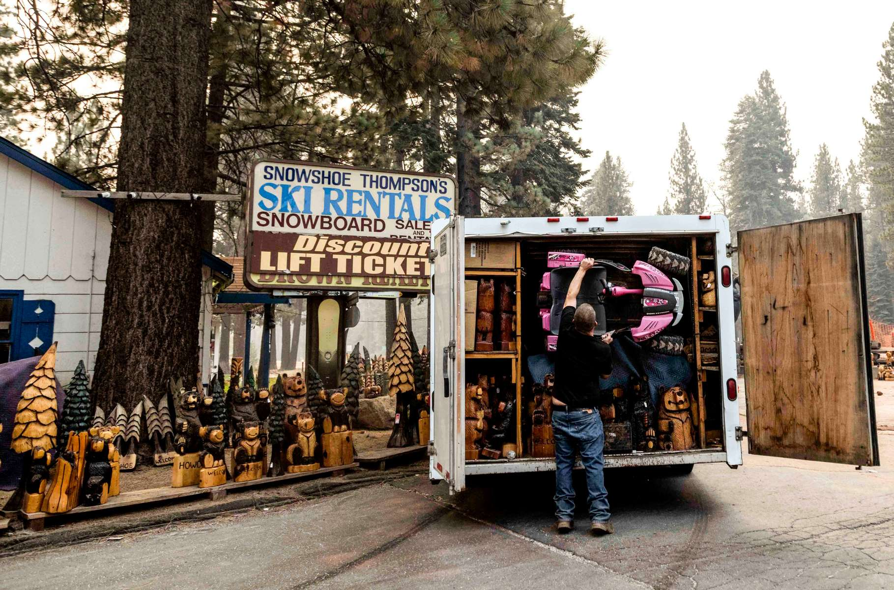 People evacuates as South Lake Tahoe is under mandatory evacuation with the Caldor fire approaching on August 30, 2021, in South Lake Tahoe, California. The Caldor Fire has burned almost 200.000 acres, destroyed over 660 structures and is currently 16 percent contained.