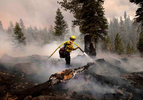 Firefighters work to control the Caldor fire on August 29, 2021, in the Eldorado National forest, California. The Caldor Fire has burned over 165,000 acres, destroyed over 660 structures and is currently 14 percent contained.