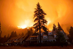 The Strawberry lodge stands as the Caldor fire rages on August 29, 2021, in the Eldorado National forest, California. The Caldor Fire has burned over 165,000 acres, destroyed over 660 structures and is currently 14 percent contained.