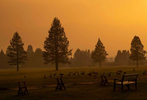 Smoke is seen over the Lake Tahoe golf course, as the Caldor fire rages near by on August 29, 2021, in South Lake Tahoe, California. The Caldor Fire has burned over 165,000 acres, destroyed over 660 structures and is currently 14 percent contained.