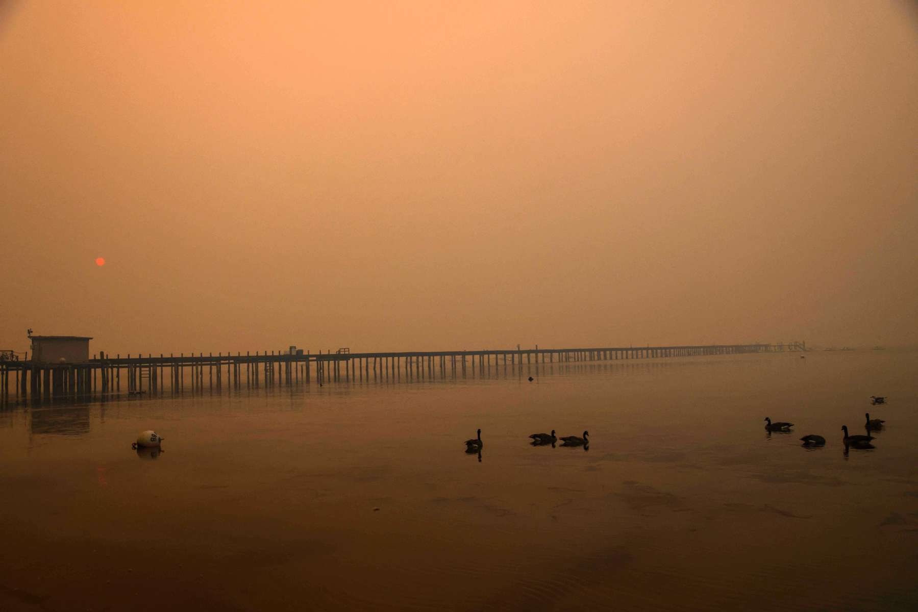 Smoke is seen on the Lake Tahoe as the Caldor fire rages near by on August 26, 2021, in South Lake Tahoe, California.The Caldor Fire has burned over 165,000 acres, destroyed over 660 structures and is currently 14 percent contained.