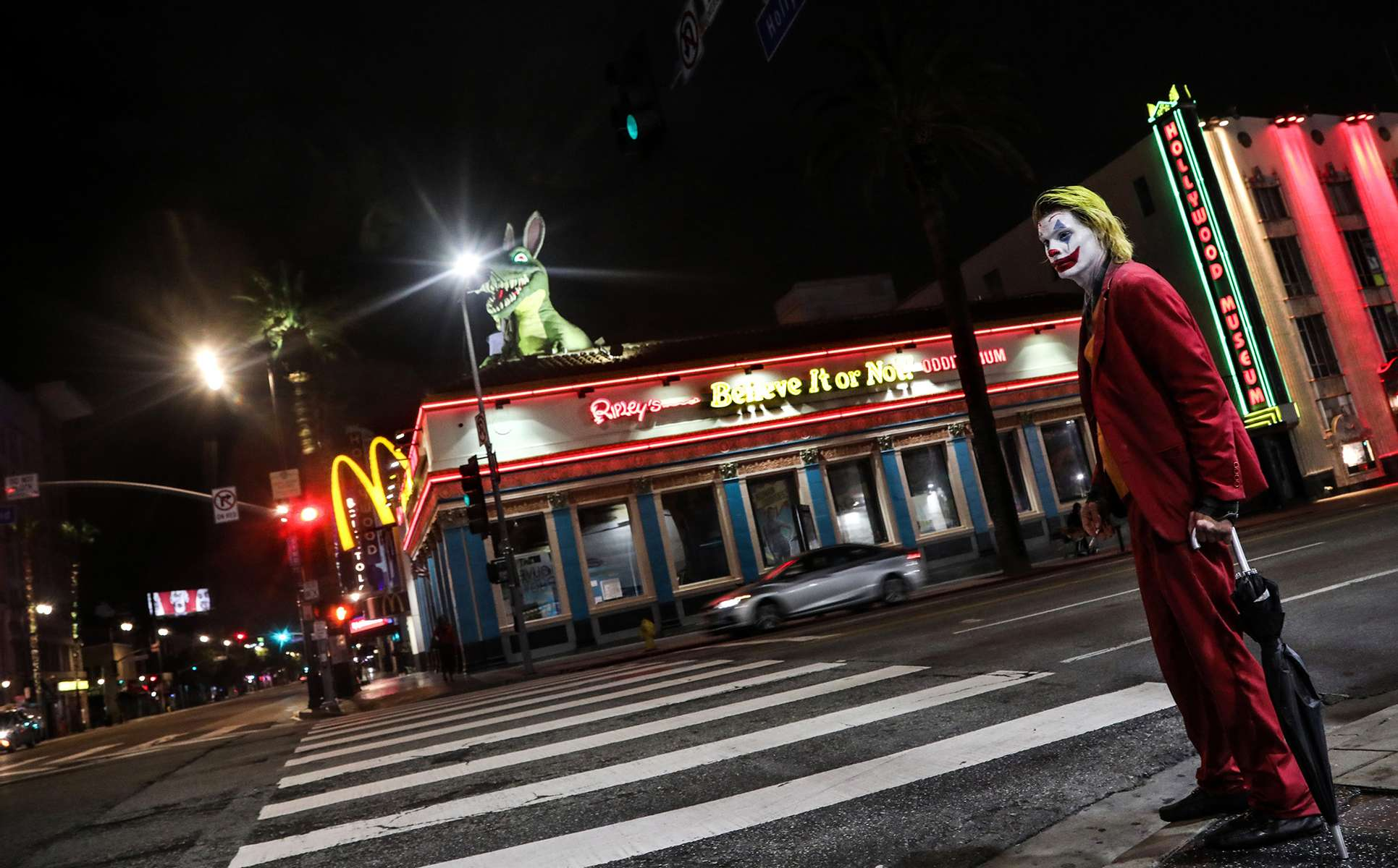 Joker, who wants to be called that way, walks home on an almost deserted Hollywood Boulevard, one hour before the beginning of the 'safer at home' order requiring people to stay home, and most {quote}non-essential{quote} businesses to close, on March 19, 2020, in Los Angeles, California. The order has just been announced a few hours before and everybody was in shock. He was upset about the order, because he wonders how many people are going to be able to survive during the next few weeks.