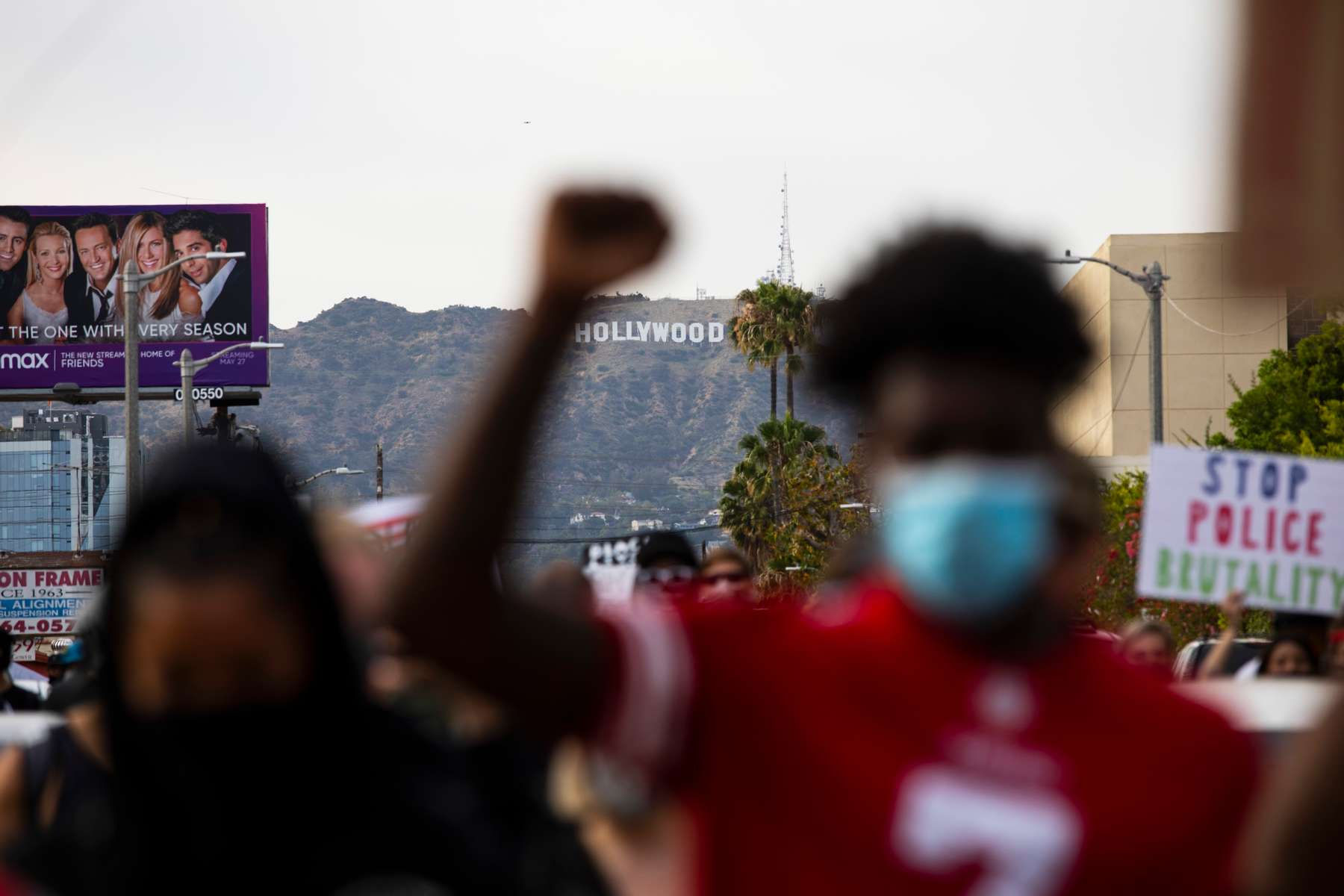 Protesters march peacefully during a march over the death of George Floyd, an unarmed black man, who died after a police officer kneeled on his neck for several minutes, in the Hollywood neighborhood on June 1, 2020, in Los Angeles, California.