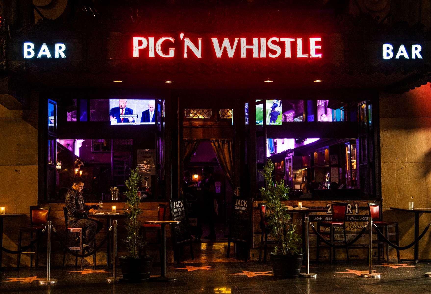 The third presidential debate is screened on TV during Happy Hour in the almost empty Pig'n Whistle on Hollywood Boulevard, on October 22, 2020.