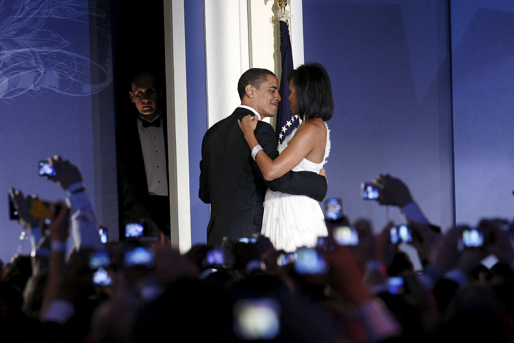 THE END OF THE ANONYMITYPresident Barack Obama and his wife Michelle open the Youth Ball, one of the inauguration balls, in  Washington, DC, January 20, 2009. They are surrounded by cameras, while a Secret Service agent watches in the shadow.