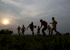 Congolese refugee girls play soccer in Kampala, Uganda on December 10, 2018.