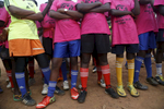 Girls listen to their coaches during the {quote}Women take the Lead{quote} festival, a soccer event for Congolese refugee youth in Kampala, Uganda on December 10, 2018.