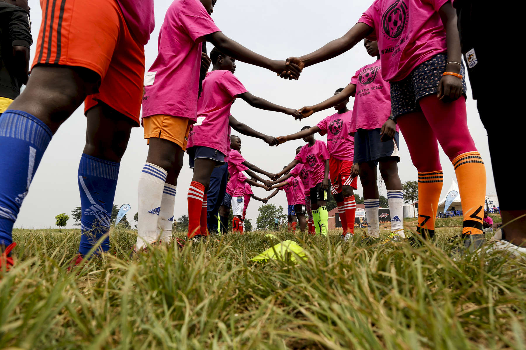Participants shake hands during a game at the {quote}Women take the Lead{quote} festival, a soccer event for Congolese refugee youth in Kampala, Uganda on December 10, 2018.