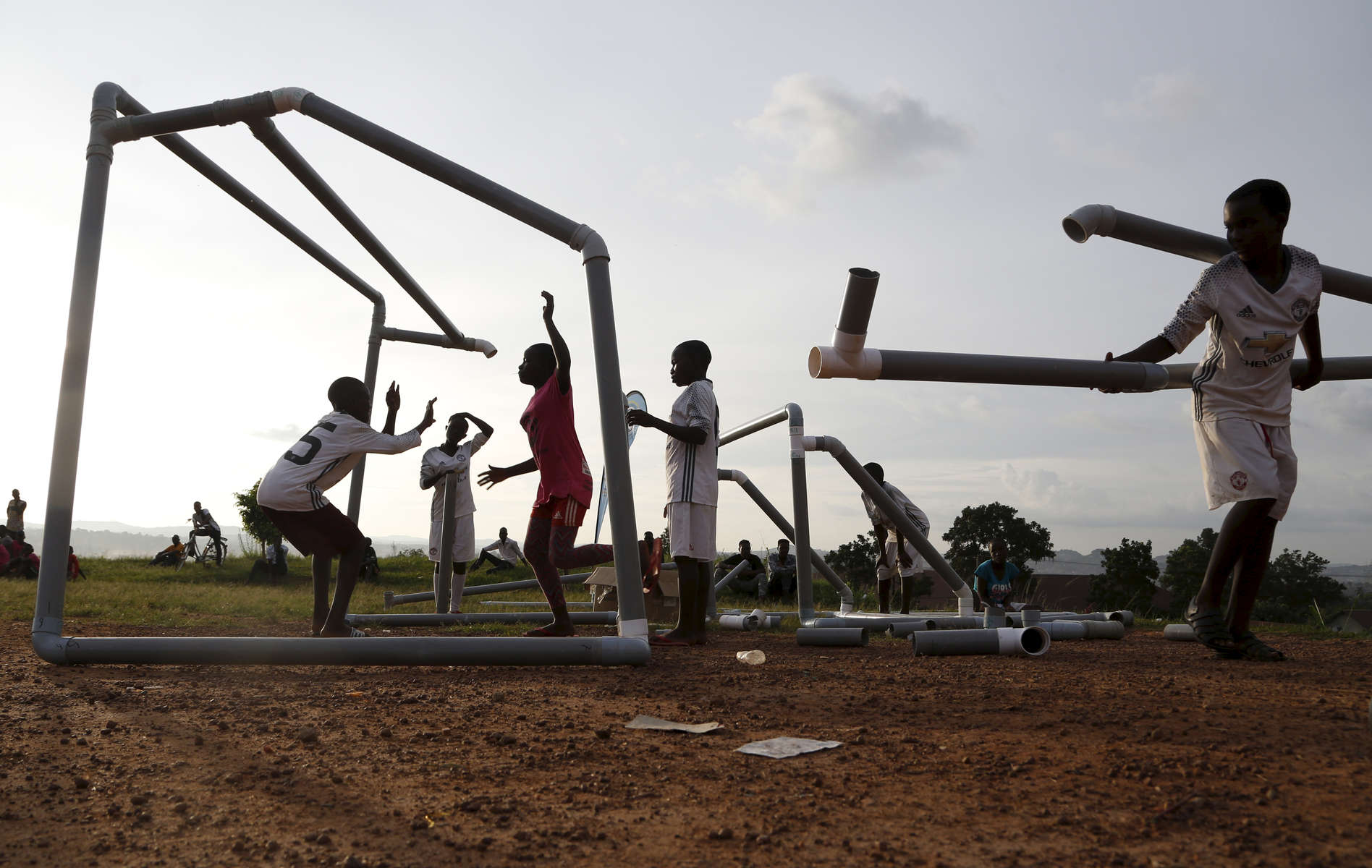 Girls unfold the soccer cage made of plastic water pipes at the end of a game during the {quote}Women take the Lead{quote} festival, a soccer event for Congolese refugee youth in Kampala, Uganda on December 13, 2018. Although Uganda is welcoming and host one of the largest population of refugees in the world, the life of refugees in Kampala, the capital, and the surrounding areas is very difficult, at best. Especially for youth, who have difficulties to access education because of financial reasons, and language barriers. In the slump of Nsambya, Soccer without Borders, an organization where most of the staff are also refugees, offer education and soccer training for these youths, helping them building strength and dealing with trauma. A special emphasis is given to empowering young women through that sport, when parents are often reluctant to let their girls play soccer. They fear they might become too masculine and would rather have their girls stay and help at home.