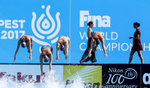The American team practices before competing in the Synchronised Swimming Team Free finals, while the FINA team rehearses the medals ceremony, during the FINA World championships in Budapest, Hungary on July 21, 2017.
