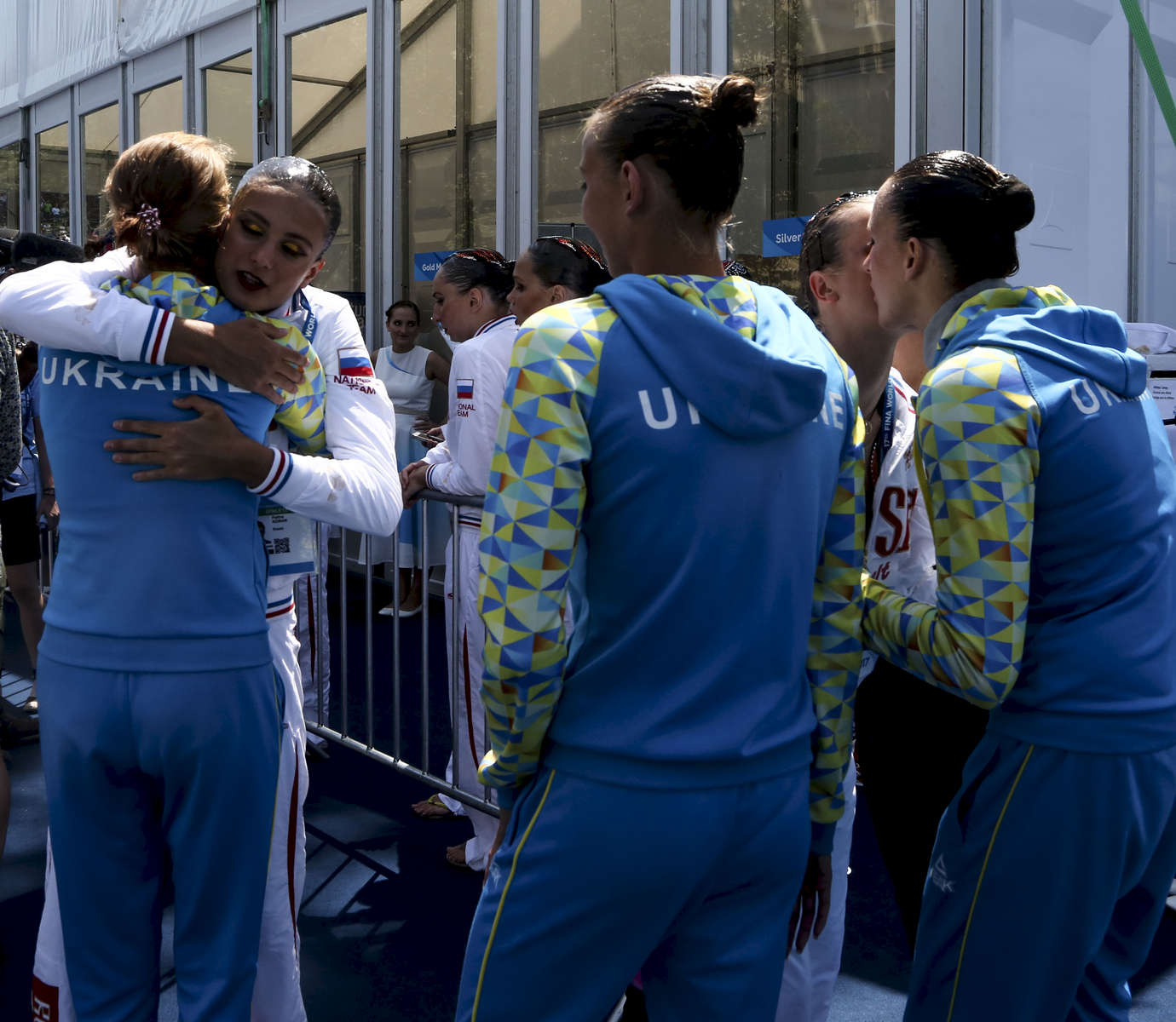 Members of the Russian and Ukrainian teams congratulate each other for their first and third places at the end of the Synchronised Swimming Team Free finals, during the FINA World championships in Budapest, Hungary on July 21, 2017.