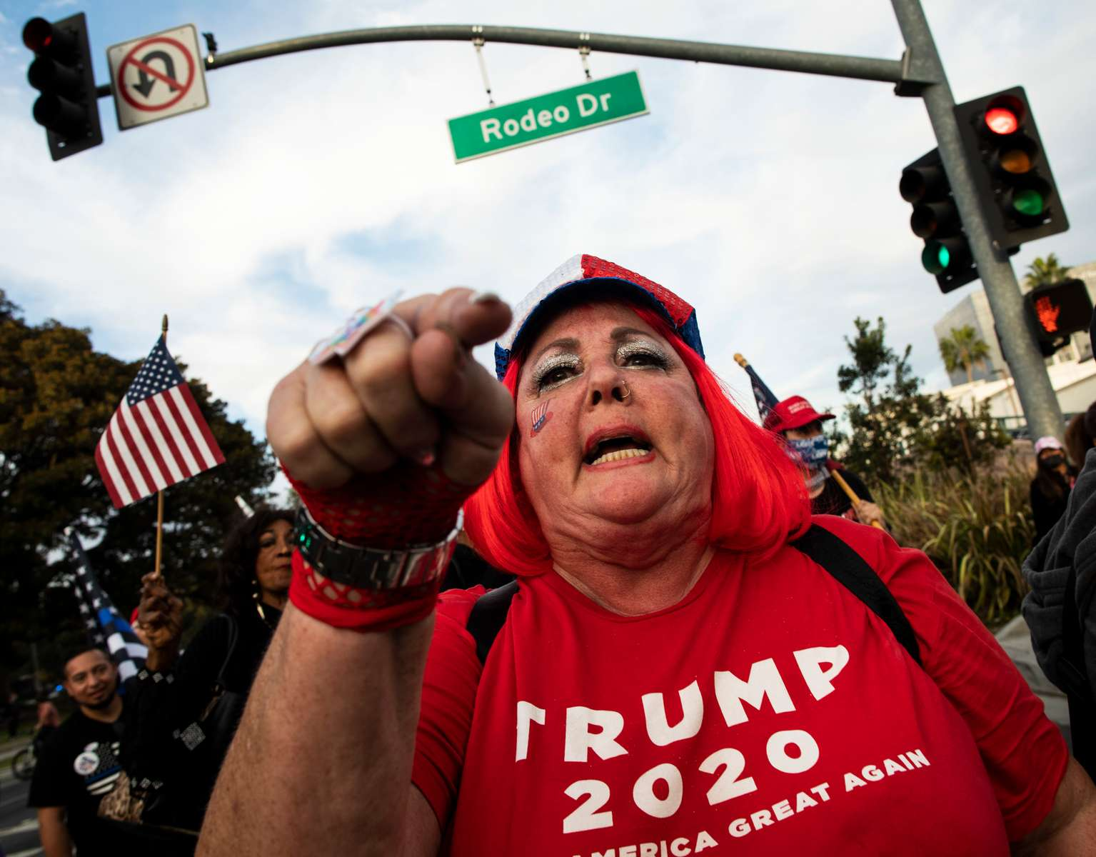 Supporters watch the plane Air Force One landing before a Make America Great Again rally of US President Donald Trump on October 28, 2020 in Bullhead, Arizona.