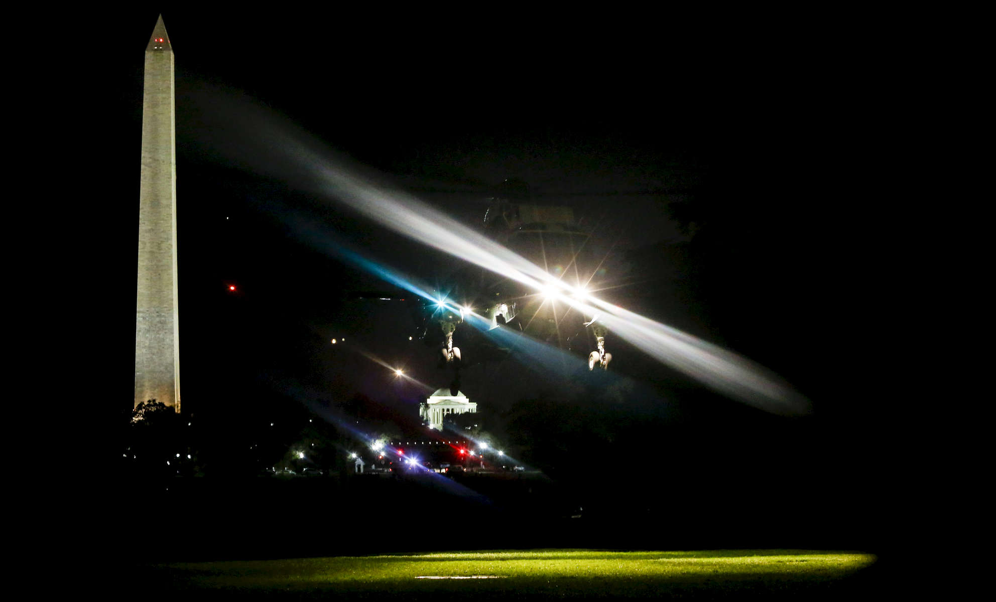 Marine One with President Obama on board, and two decoys fly back to the White House.