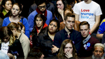 People react at the voting results at the Hillary Clinton's election night event in New York.